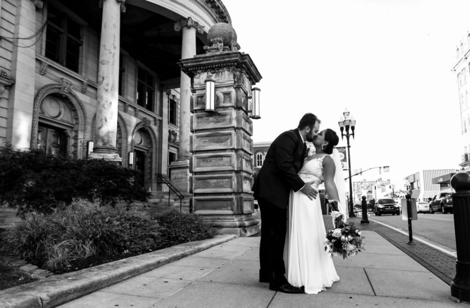 Bride and groom kiss outside the Washington County Courthouse