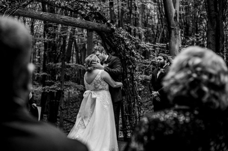 First kiss from a guest's perspective at a Majestic Woods wedding