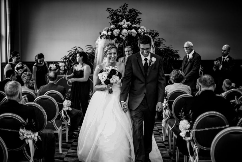 Recessional portrait of bride and groom at a Sheraton Erie Bayfront Hotel wedding