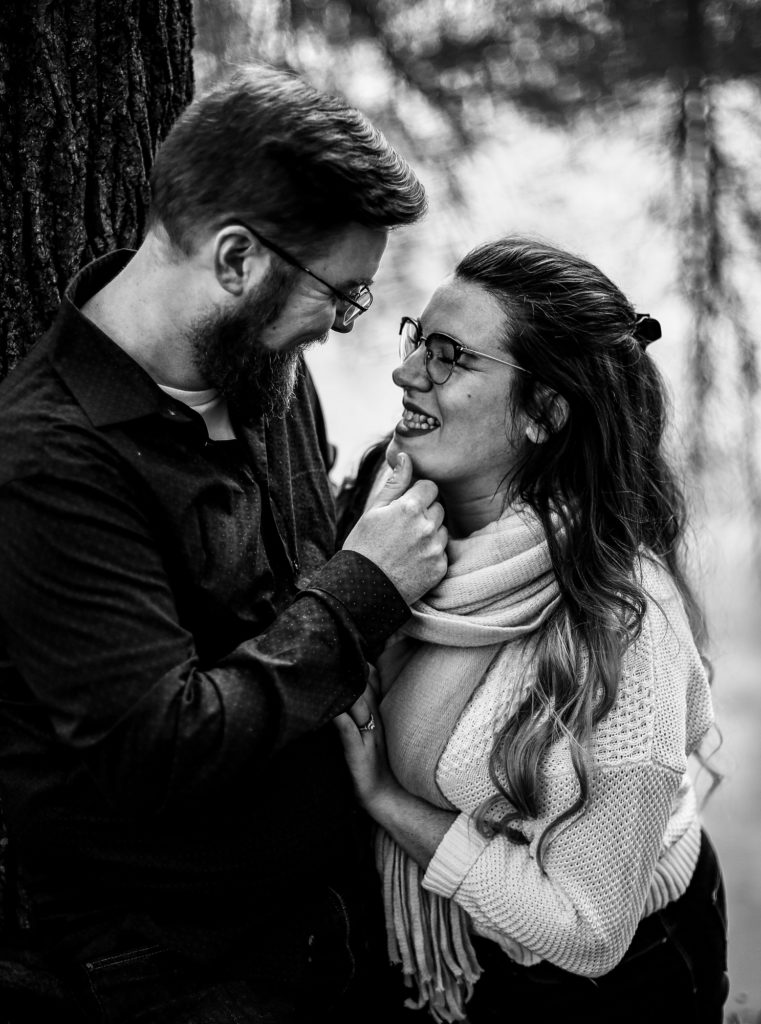 Man touches fiancee's chin in engagement photos around Erie PA