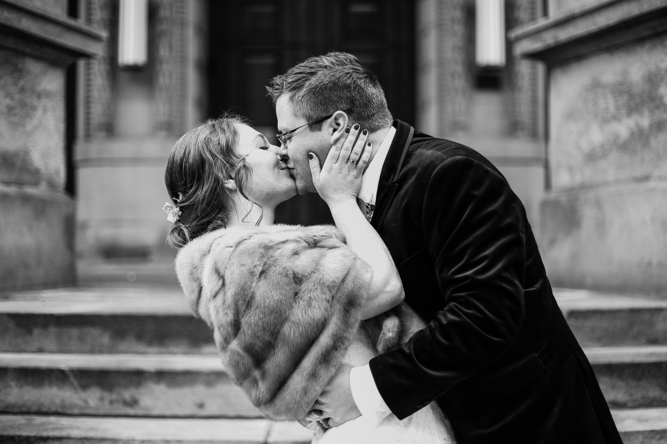 Bride and groom kiss on the steps of the Washington County Courthouse