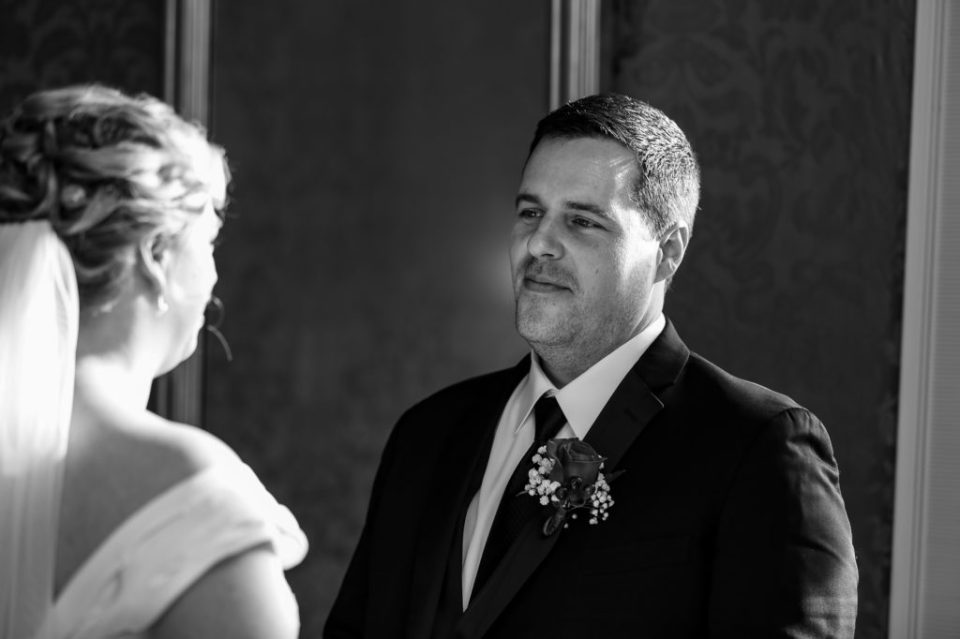 Groom reacts to seeing his bride at Watson Curtze Mansion in Erie, PA