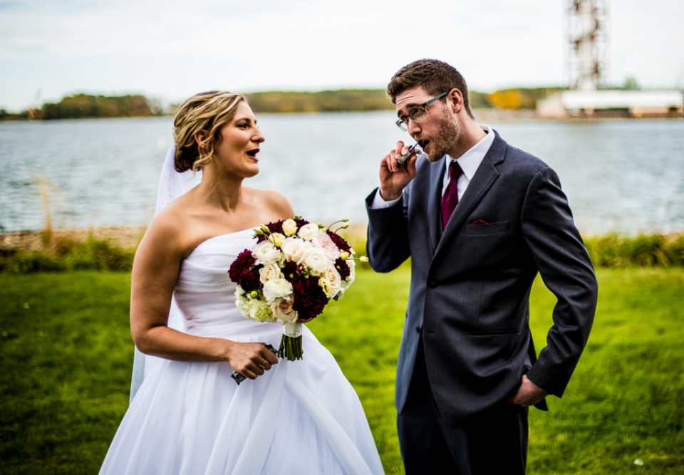 Bride and groom munch on candy bars during bridal portraits