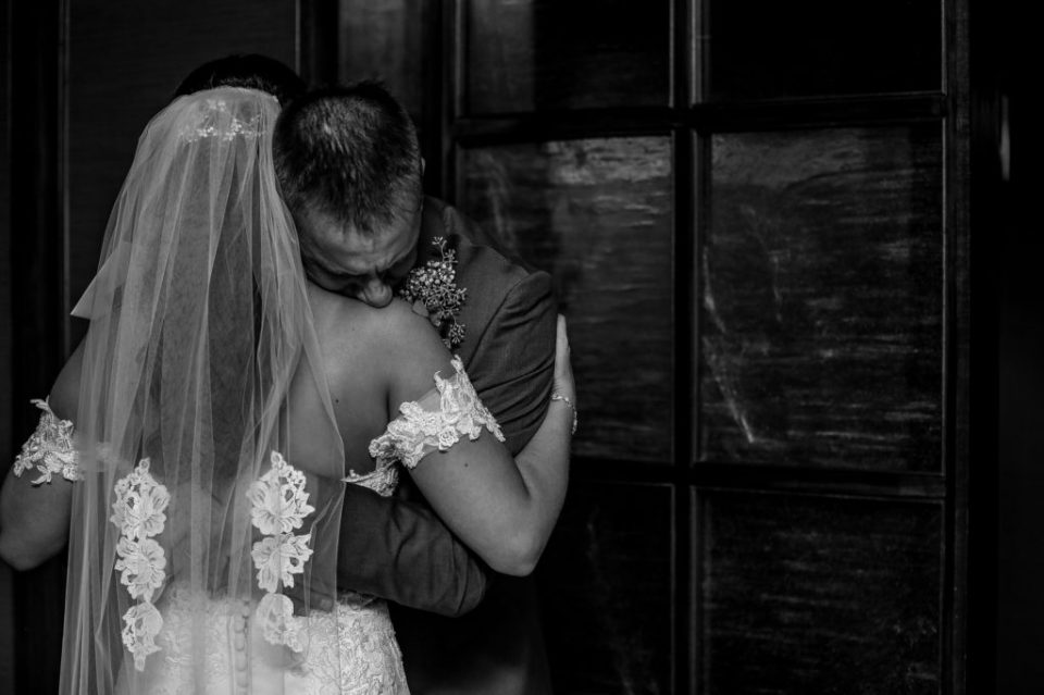 Father hugs his daughter, the bride, before her wedding ceremony at the Sheraton Bayfront Hotel in Erie, PA
