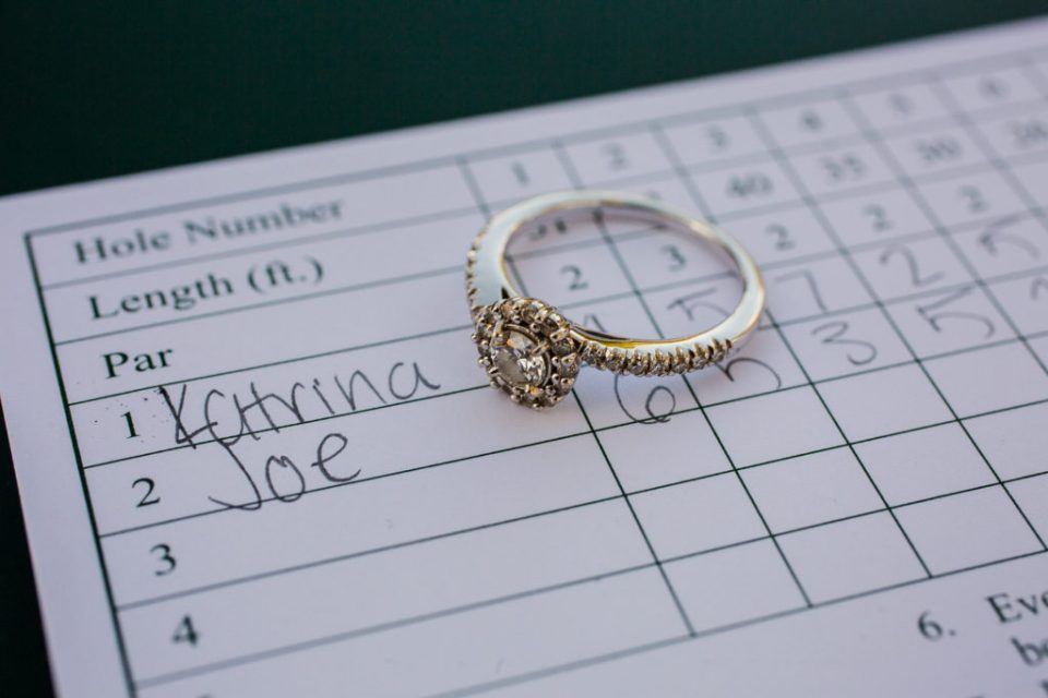 Engagement ring sits on Harborview Miniature Golf Course score card