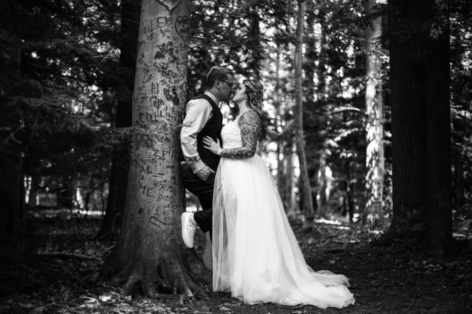 Couple kisses among trees at Asbury woods
