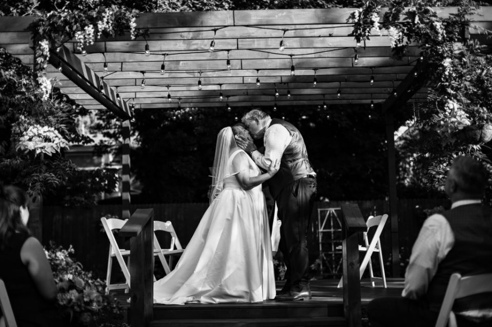 Couple shares first kiss at the end of their back garden wedding in Erie, PA