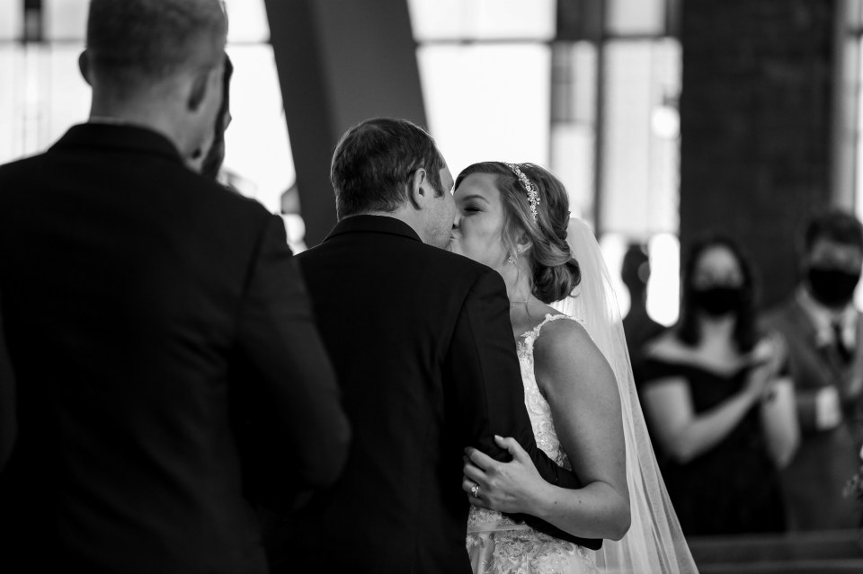 Couple's first kiss at their St George Church wedding in Erie PA