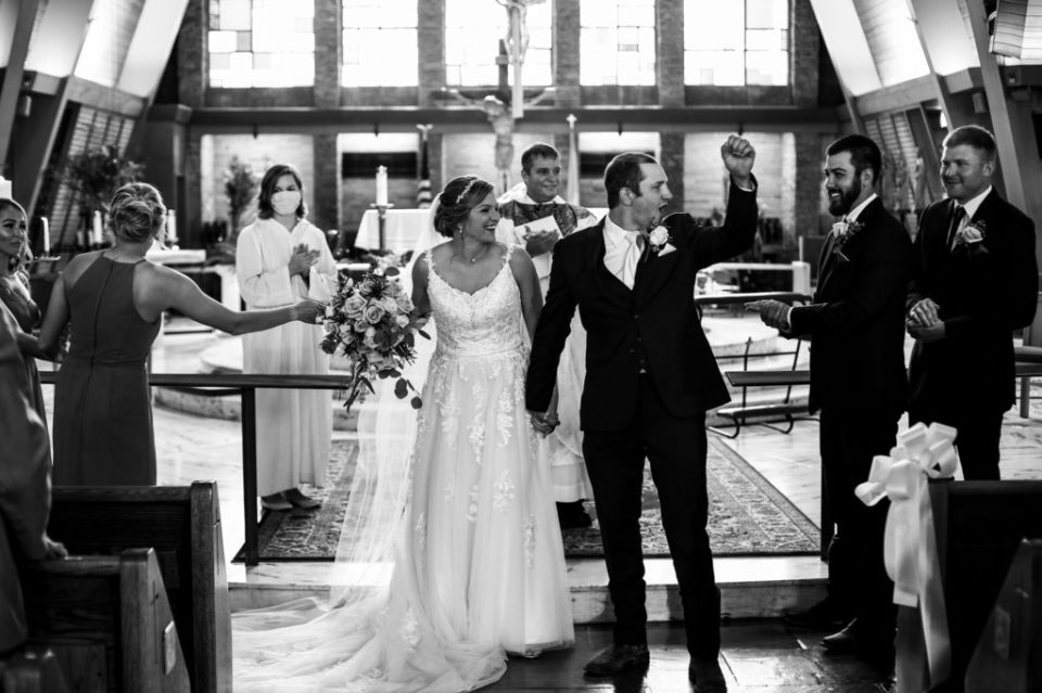 Recessional of bride and groom at their St George Church wedding in Erie PA
