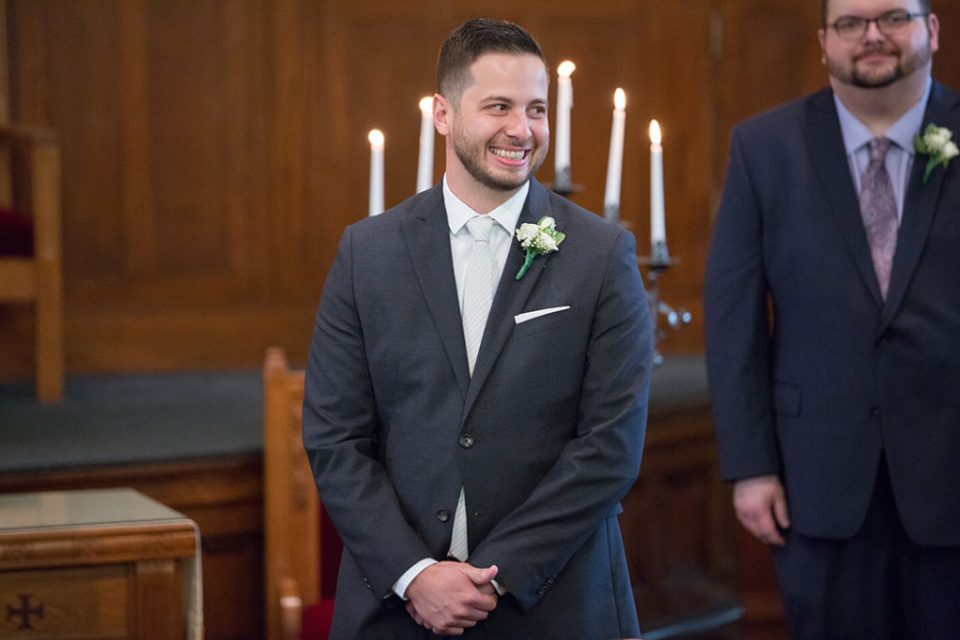 Groom smiles and fights back tears as he watches bride walk down the aisle in Pittsburgh, PA wedding