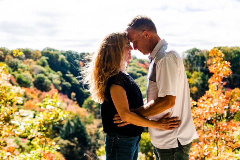 Newly married couple stand forehead to forehead at scenic overlook at Wintergreen Gorge in Erie, PA