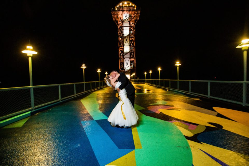 Bride and groom kissing at the base of the Bicentennial Tower in Erie, PA