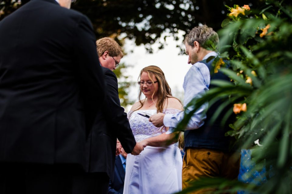 Couple exchanges vows during intimate wedding at their home in Erie,PA