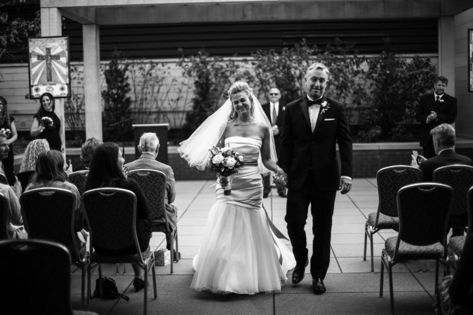 Recessional of bride and groom at Anchor Plaza wedding Erie, PA