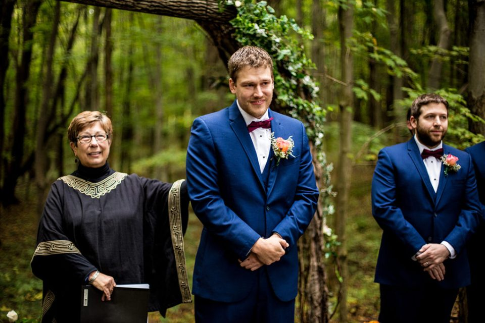 Groom tears up as he watches his bride walk down the aisle at Majestic Woods wedding
