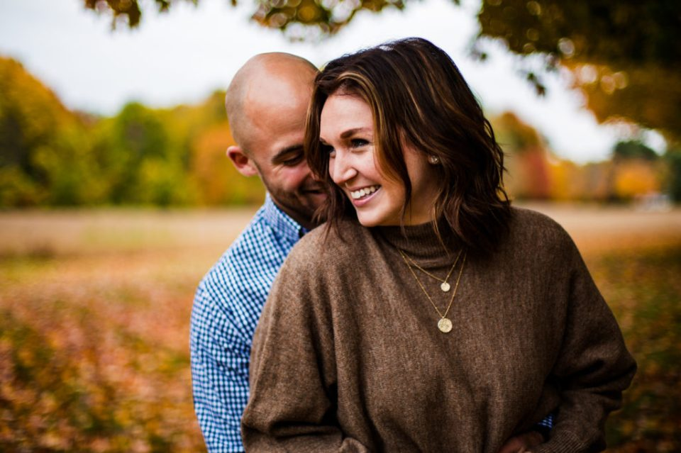 Smiling engaged couple on family property in Girard, PA