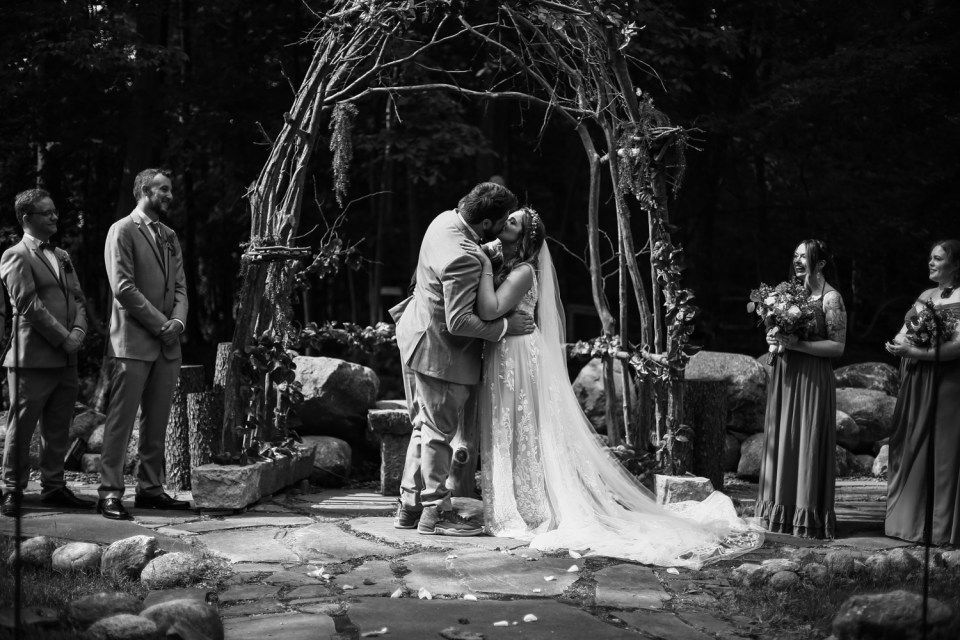 First kiss at Whispering Trees Manor wedding