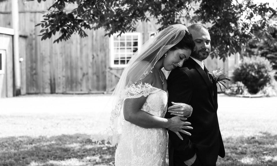 bride rests head on groom's shoulder at Port Farms