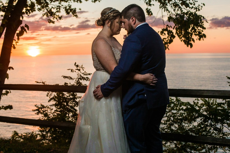 Bride and groom embracing at sunset at Beach Glass Estates wedding