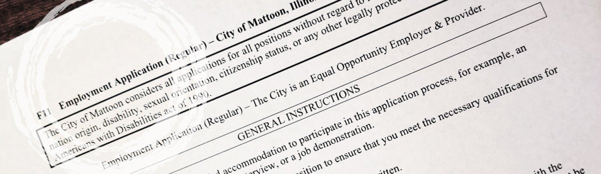 Employment application for City of Mattoon, sitting on table.