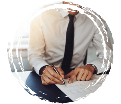 Man sitting at desk calculating finances.