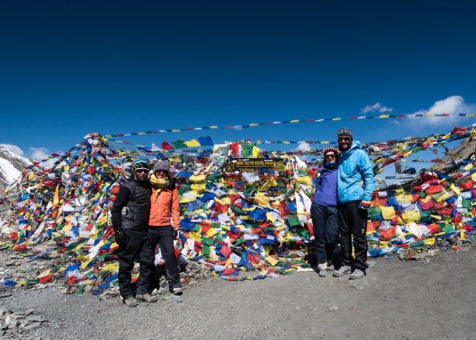 The A-Team standing on top of the Annapurna Circuit - post hanging of some prayer flags