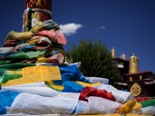 Prayer flags in Barkhor Square with Jokhang Temple in the background