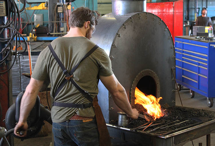 Paul Nyborg firing up his forge.