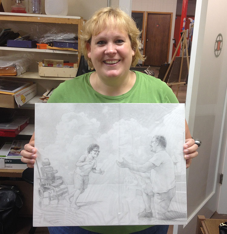 Pencil portrait artist Matt Philleo's client, Karla, holding a drawing he did of her late son and husband in July 2016.