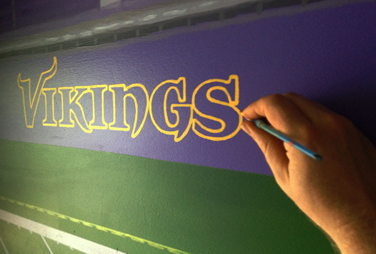 Painting in the logo precisely.