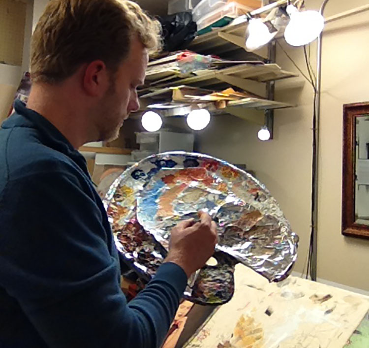 Portrait painter Matt Philleo mixing colors on his palette at Artisan Forge Studios on October 29, 2016