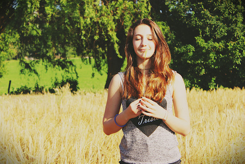 happy girl in field of wheat