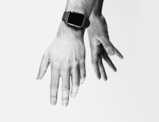 black and white photo of hands together against blank background