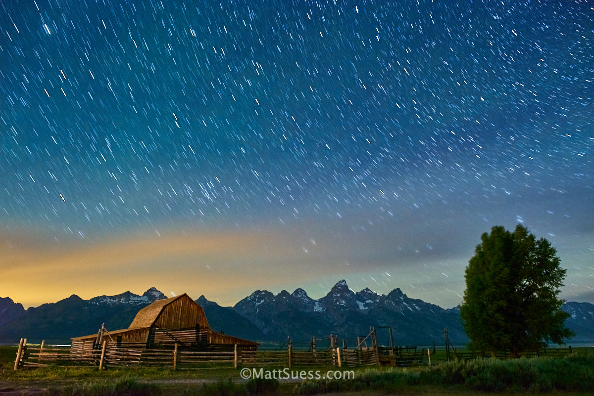Milky Way and lightpainting during summer at Grand Teton National Park in Wyoming at T.A. Molten Barn. Mormon Row Barns.