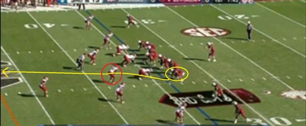 Cunningham begins the play with an outside release and then works under the Arkansas linebacker to get up the seam.