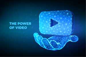 How to start a video marketing business using the power of video hand holding a video screen digitalised