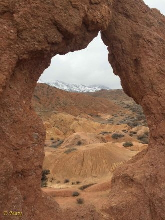 Window on the snow in the mountains at the Skazka