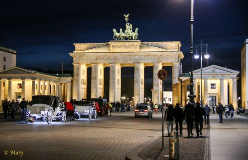 Brandenburg Gate at night - plenty of folks walking around - great site