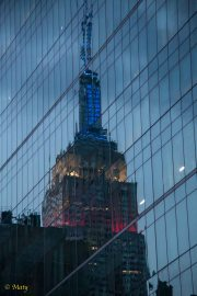 The Empire State Building reflected in the glass