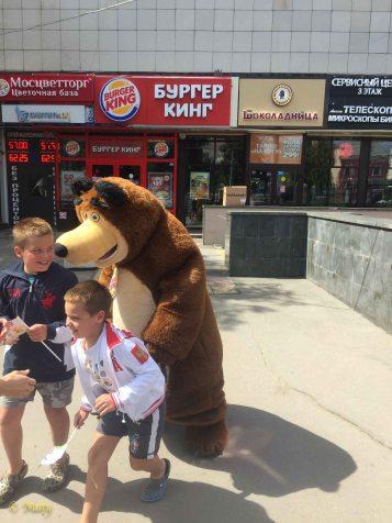 Bear chasing kids