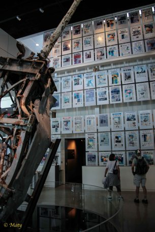 Top of the transmission antenna from WTC and reprints of newspaper's front pages from 9/11