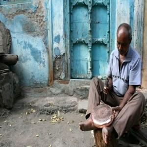 Tambat-coppersmith-beating-a-bowl