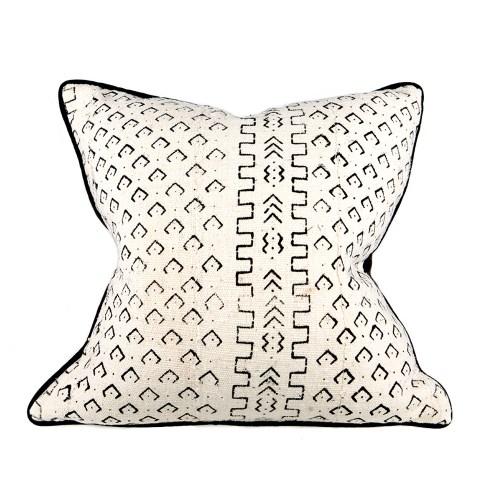 cream and black cushion