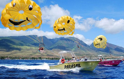 Three Lahaina parasailing boats side by side off the coast of west Maui