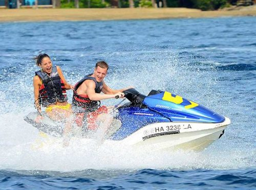 Couple having fun on jet ski maui