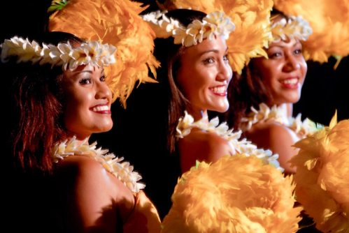 Three hula dancers performing at Old Lahaina Luau