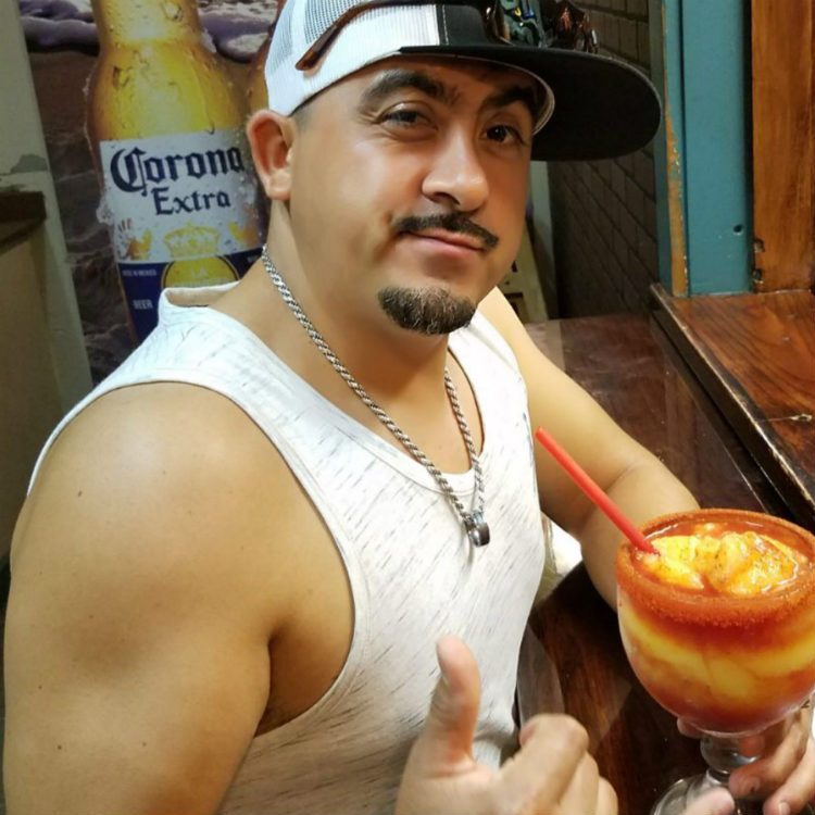 jesus ortega of amigos kihei with frozen margarita - maui happy hours