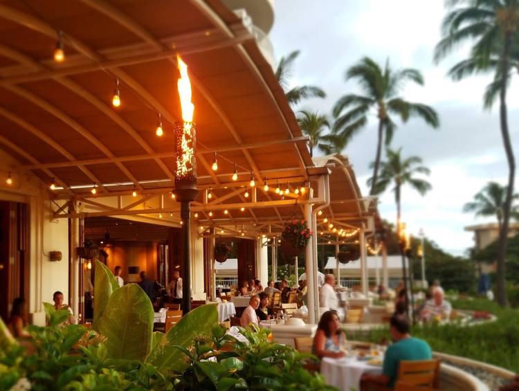 tiki torch hawaiian dining at nicks fishmarket wailea maui restaurant