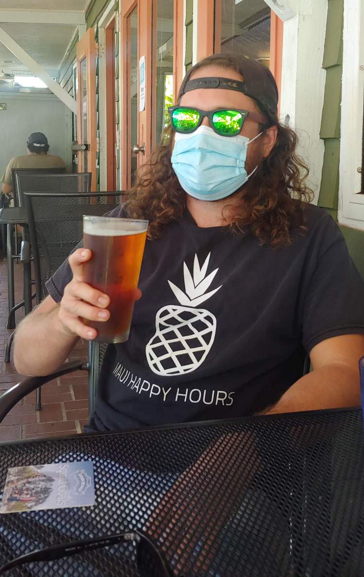 russell snyder maui happy hours mask at bar with beer