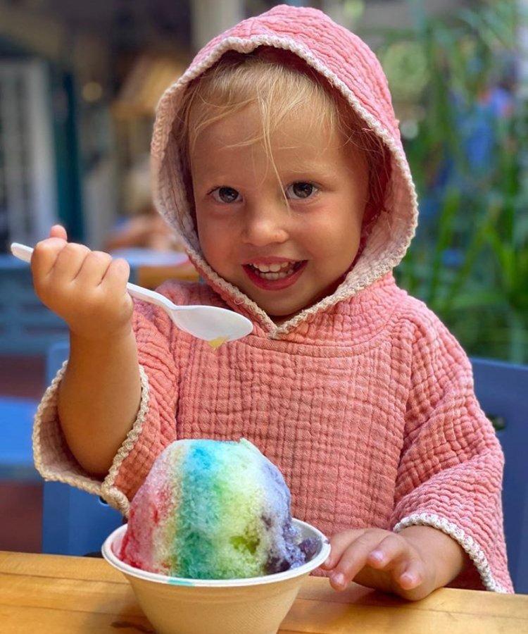 cute kid eating Hawaiian shave ice in lahaina maui hi